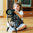 Child takes photo with camera — Stock Photo