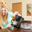 Woman with new electric coffee maker at home — Stock Photo