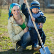 woman and boy working with spade — Stock Photo