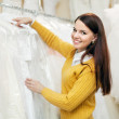 Girl chooses wedding outfit — Stock Photo