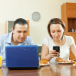 Couple looking e-mail during breakfast — Stock Photo #30997919