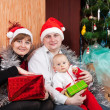Happy family near Christmas tree — Stock Photo #30997965