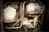 Vintage photo of tractor engine — Stock Photo