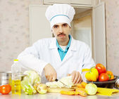 Portrait of cook with vegetables — Stock Photo