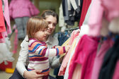 Woman and child chooses wear at shop — Stock Photo