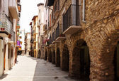 Picturesque street of old Catalan town — Stock Photo