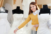 Bride chooses wedding gown — Stock Photo