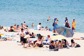People sunbathing at Bogatell beach in Barcelona — Stock Photo