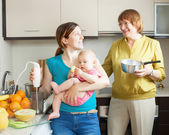 Happy family cooking fruit puree — Stock Photo