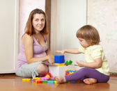 Family plays in home — Stock Photo