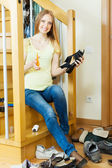 Smiling long-haired woman with shoes — Stock Photo