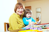 Happy mature woman and child — Stock Photo