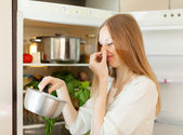 Woman holding her nose because of bad smell — Stock Photo