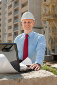 Happy builder works on the building site — Stock Photo