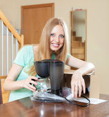 Happy young blond with new coffee maker in home interior — Стоковое фото