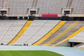 Empty grandstand of the large stadium — Stock Photo