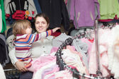Happy family at clothes shop — Stock Photo