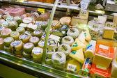 Cheese on counter in European market — Stock Photo