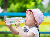 2 years child drinks from plastic bottle — Stockfoto