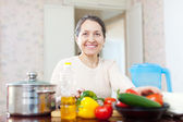 Woman cooking veggie lunch — Stock Photo