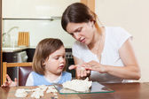 Mom and daughter mold dough figurines — Stock Photo