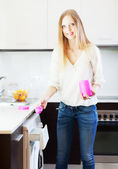 Blonde woman doing laundry with detergent — Stock Photo