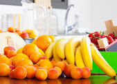 Heap of fresh fruits at table — Stock Photo