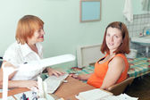 Mature doctor examining the pregnant woman — Stock Photo