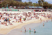 People sunbathing at Nova Icaria beach in Barcelona — Stock Photo