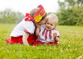 Two happy children in folk clothes in summer — Stock Photo