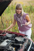Young woman with her broken car — Stock Photo
