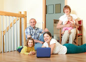 Portrait of smiling happy three generations family with two chil — Stock Photo