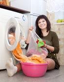 Housewife loading washing machine — Foto de Stock