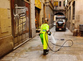 Wet cleaning of ancient streets in Barcelona, Spain — Foto Stock