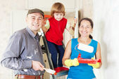 Family of three makes repairs at home — Stock Photo