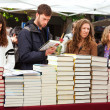 Books on street stalls in Saint George day. Focus on books — Stock Photo