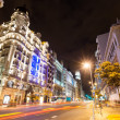 Stock Photo: Wide angle shot of GrVistreet in night. Madrid, Spain