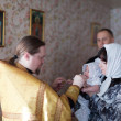 Priest at Sretenskaya church performing christening ceremony — Stock Photo