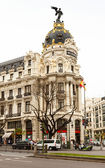 Building at crossing the Calle de Alcala and Gran Via in Madrid — Stock Photo
