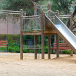 Wooden and metal playground area — Stock Photo