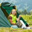 Happy  hiker in camp tent   — Stock Photo