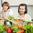 Stock Photo: Cute couple preparing a meal of vegetables