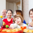 family posing together over tea at home  — Stockfoto