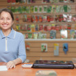 Saleswoman at shop for gardener — Lizenzfreies Foto