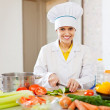 Cook  in toque prepares veggie lunch — Stock Photo