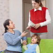 Mother leaving baby with babysitter — Stock Photo