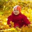 Toddler   in autumn park — Stock Photo