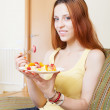 Woman eating fruits salad   — Stock Photo