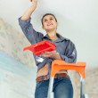 Stock Photo: Wompaints ceiling with brush
