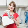 Woman with electric mincing machine — Stock Photo
